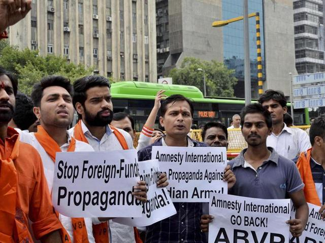 ABVP activists shout slogans at a protest against Amnesty International India in New Delhi,  August 17