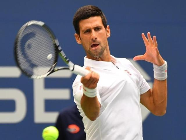 Novak Djokovic of Serbia hits a return in his match against Kyle Edmund of Great Britain.