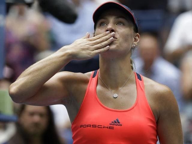 Angelique Kerber of Germany hits a return against Roberta Vinci of Italy.
