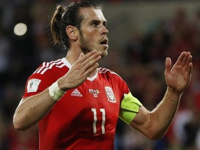 Wales' Gareth Bale celebrates scoring their fourth goal from the penalty spot.