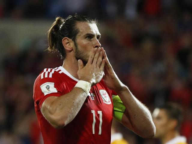 Gareth Bale scores the fourth goal for Wales with a penalty.