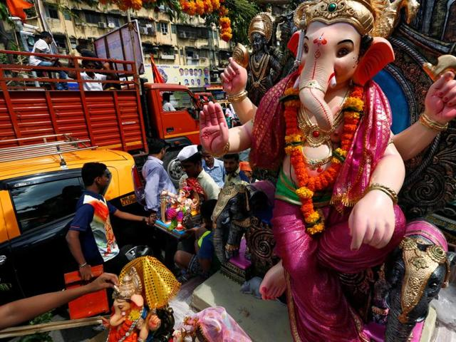 Idols of Lord Ganesha are being transported to places of worship on the first day of the Ganesh Chaturthi festival in Mumbai.(Reuters Photo)