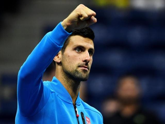 Novak Djokovic of Serbia returns a shot to Jo-Wilfried Tsonga of France.