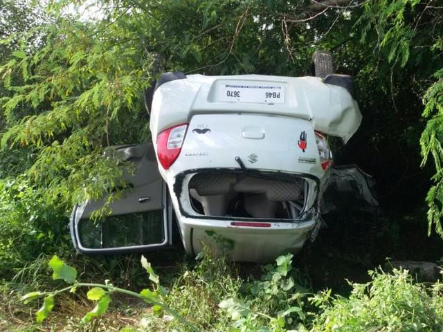 The overturned car on Wednesday. A two-year-old and a five-year-old  are among the four dead.