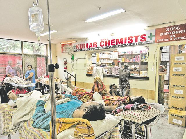 Patients lying on stretchers next to a chemist shop at the PGI advanced trauma centre in Chandigarh on Tuesday.