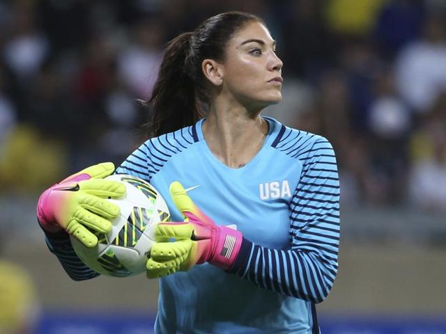 United States' goalkeeper Hope Solo takes the ball during a women's game at the Rio Olympics.