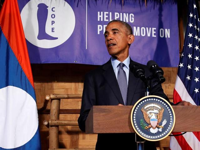 US President Barack Obama gestures as he delivers a speech about US-Laos relations at the Lao National Cultural Hall in Vientiane on Monday.