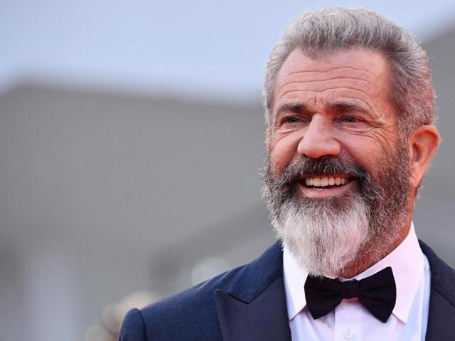 Director and actor Mel Gibson poses as he arrives on the red carpet for Hacksaw Ridge at the 73rd annual Venice International Film Festival.