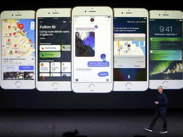 Apple Inc CEO Tim Cook discusses the iPhone during the Apple media event in San Francisco, California, U.S. September 7, 2016.