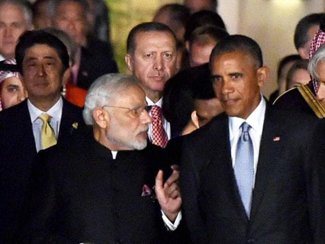 Prime Minister Narendra Modi with US President Obama and other G20 leaders arrive for group photo during the G20 summit in Hangzhou, China.  The Guardian drone deal was the first major request of arms sale purchase by India after Obama designated New Delhi as a major 'strategic defence partner'.