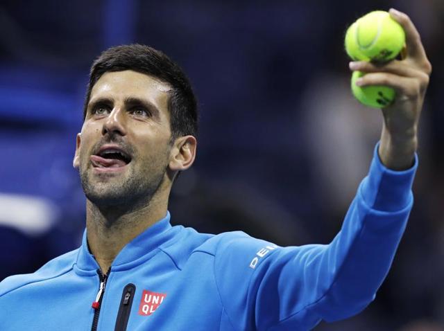 Djokovic and Tsonga embrace at the net after the match.