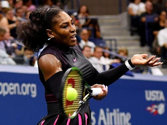 Serena Williams of the United States returns a shot to Simona Halep of Romania.