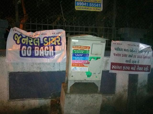 Posters criticising BJP president Amit Shah and calling him names are seen on a street in Surat.