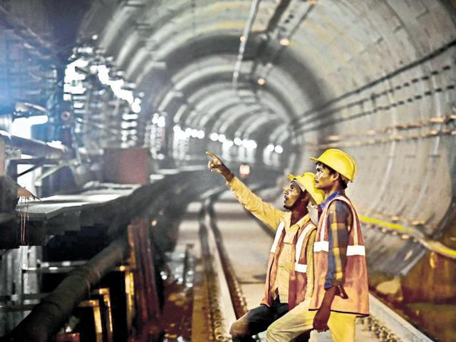 Workers inspect construction work at Delhi Gate Metro Station in Delhi. The government aims to reform laws with a bill in Parliament.