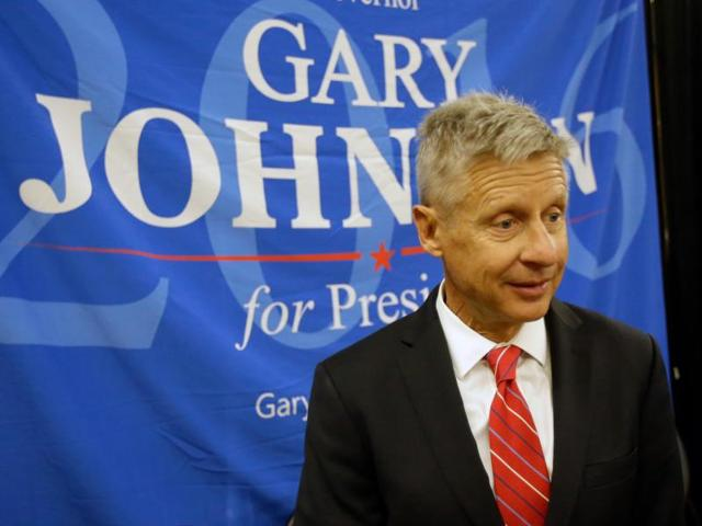Libertarian presidential candidate Gary Johnson reacts as his microphone stops working during a campaign rally. A former Republican governor of New Mexico, he has been trying to turn the two major candidates' negative approval ratings to his advantage.