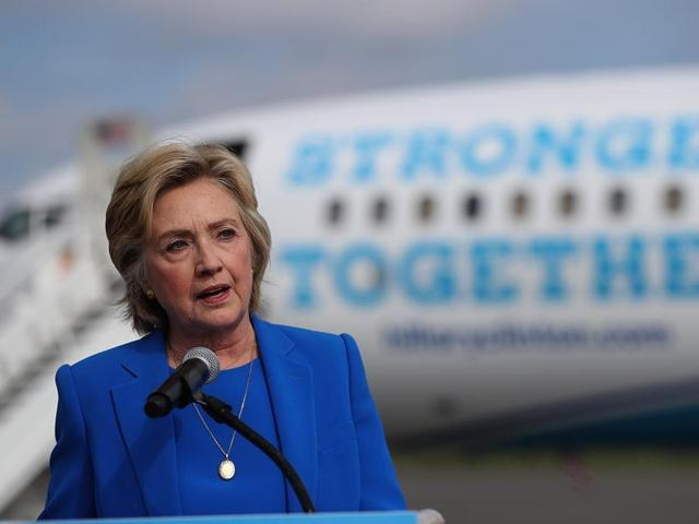 Democratic presidential nominee Hillary Clinton speaks to reporters on the tarmac at Westchester County Airport.