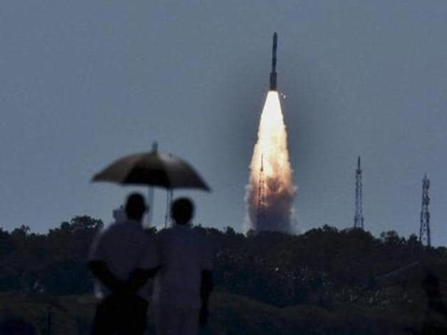 People look at PSLV C-34 rocket as it propels into sky after being launched from the Satish Dhawan Space Centre at Sriharikota.