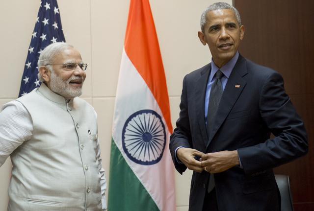 US President Barack Obama (R) meets with India's Prime Minister Narendra Modi on the sidelines of the ASEAN Summit in Vientiane on Thursday.