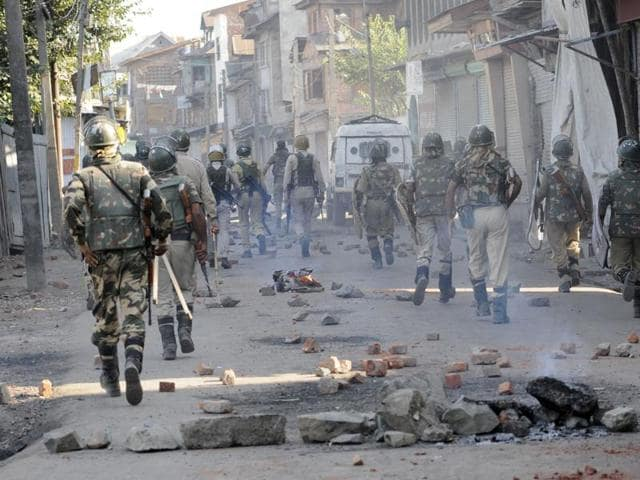 Paramilitary soldiers arrive during clashes in Batamaloo area of in Srinagar on Wednesday.