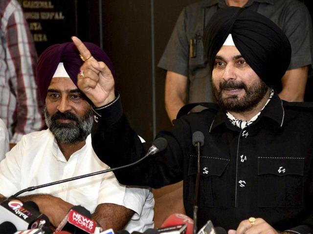 Founder of new front 'Awaaz-e-Punjab' Navjot Singh Sidhu addresses a press conference in Chandigarh on Thursday.