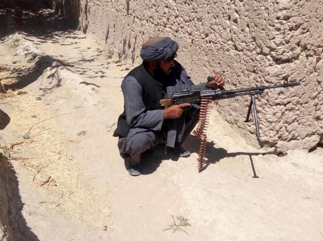An Afghan soldier patrols during ongoing fighting with the Taliban in Tarin Kot district of Uruzgan province on Thursday. The Taliban stormed Tarin Kot, triggering heavy fighting around government buildings as panicked residents scrambled to flee the capital of southern Uruzgan province.