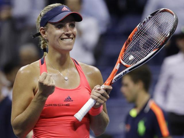 Angelique Kerber, of Germany, reacts after defeating Caroline Wozniacki, of Denmark.