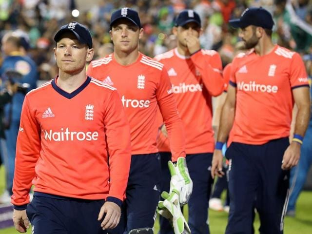 England's Eoin Morgan leads his players off the pitch after losing against Pakistan.