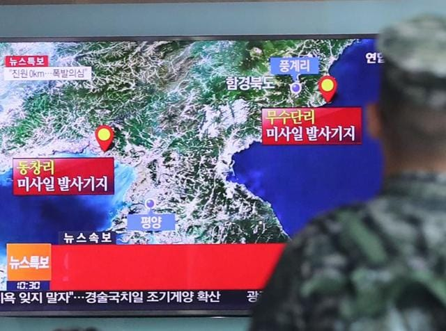 A South Korean marine watches a TV screen reporting about North Korea's possible nuclear test at the Seoul Railway Station in Seoul, South Korea.