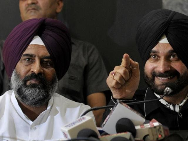 Navjot Singh Sidhu with MLA Pargat Singh during a media interaction at the Chandigarh Press Club in Chandigarh on September 8, 2016. MLA Balwinder Singh Bains was also present.