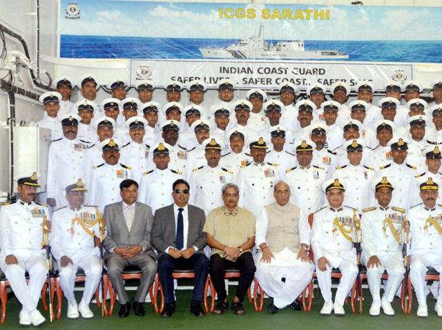 Home minister Rajnath Singh with defence minister Manohar Parrikar, Indian Coast Guard DG Rajendra Singh and ICG personnel at the commissioning ceremony of the OPV Sarathi at Goa Shipyard Ltd. Vasco on Friday.