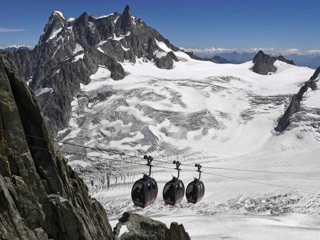 French officials say that 110 people are stuck on a series of cable cars over the Mont Blanc massif in the Alps.