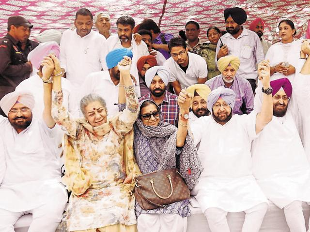 PPCC chief Captain Amarinder Singh with other party leaders during 'Kisan Chetna Dharna' at Bathinda on Thursday.