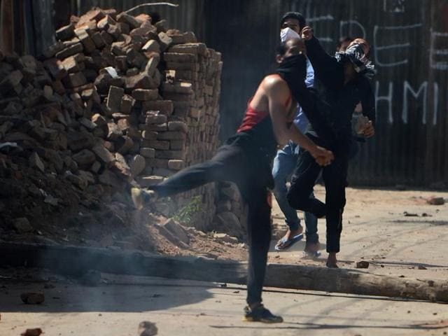 Protestors clash with security forces in Srinagar on Friday.