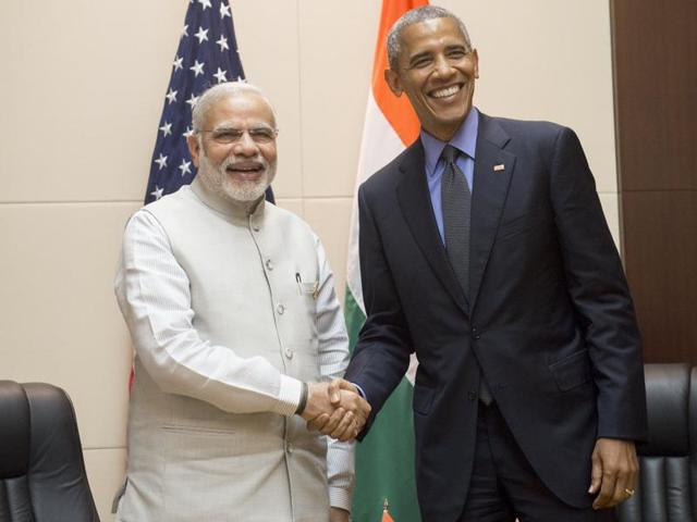 US President Barack Obama (R) shakes hands with India's Prime Minister Narendra Modi prior to a meeting on the sidelines of the Asean Summit in Vientiane on Thursday.