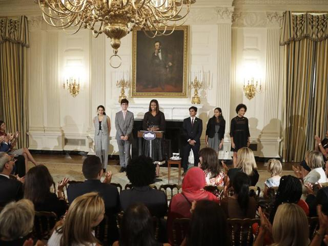 Guests applaud after a speech by first lady Michelle Obama during the fifth annual class of the National Student Poets Program.