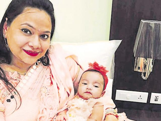 Neha Goyal with her daughter. The woman had posted photos with her infant on Facebook a month before committing the murder.