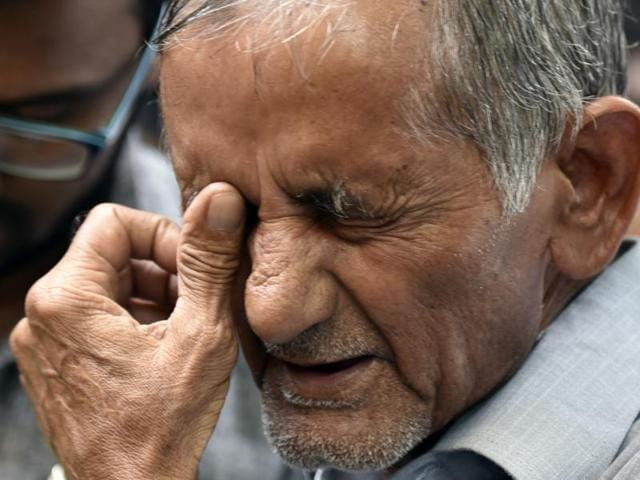 Preeti's father Amarsingh breaks down outside the court after her killer was handed the death sentence.