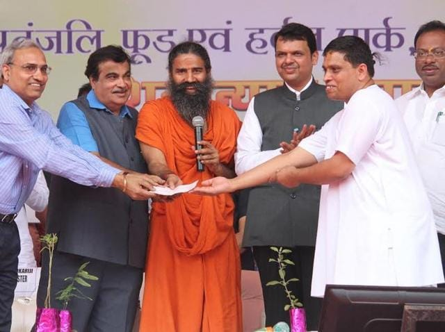 Union minister Nitin Gadkari, Baba Ramdev and chief minister Devendra Fadnavis at the launch of Patanjali food park