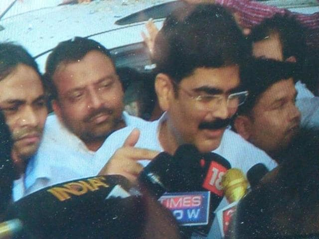 RJD leader Mohammad Shahabuddin talk to reporters after he walked out on bail.