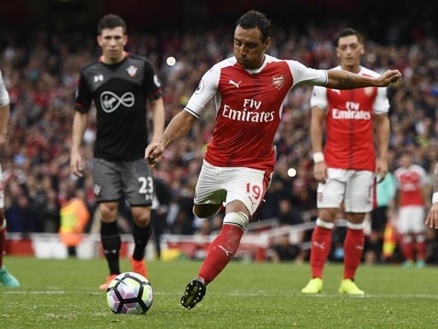 Arsenal's Laurent Koscielny celebrates scoring their first goal with teammates.