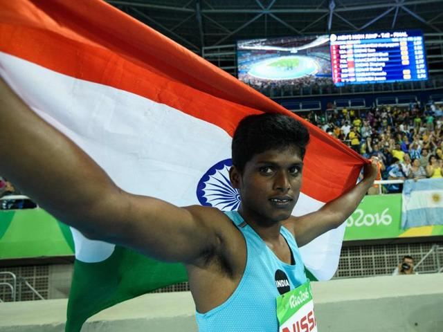 Mariyappan Thangavelu (L) and Varun Singh Bhati celebrate their gold and bronze medals, respectively.