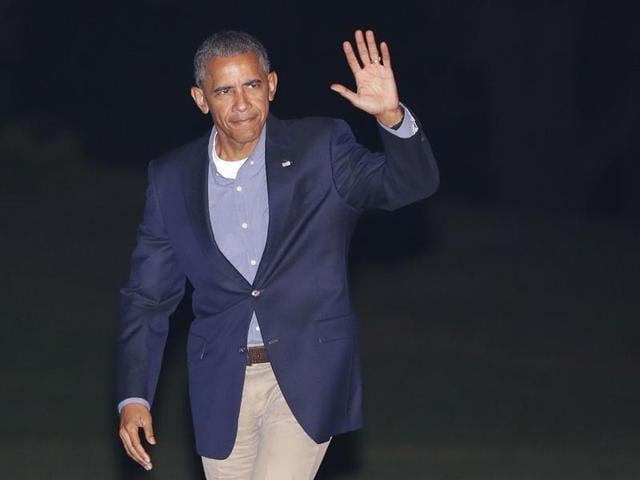 President Barack Obama waves to members of the media as he walks across the South Lawn of the White House in Washington on Friday, Sept. 9, 2016.
