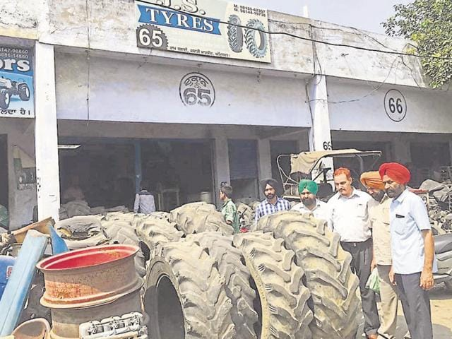 Health and MC officials at a tyre shop during their anti-dengue operation in the Jahazgarh area of Amritsar on Friday.