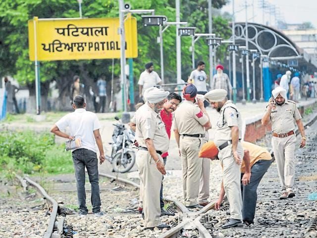 Railway Police officials inspecting the tracks in Patiala on Friday.