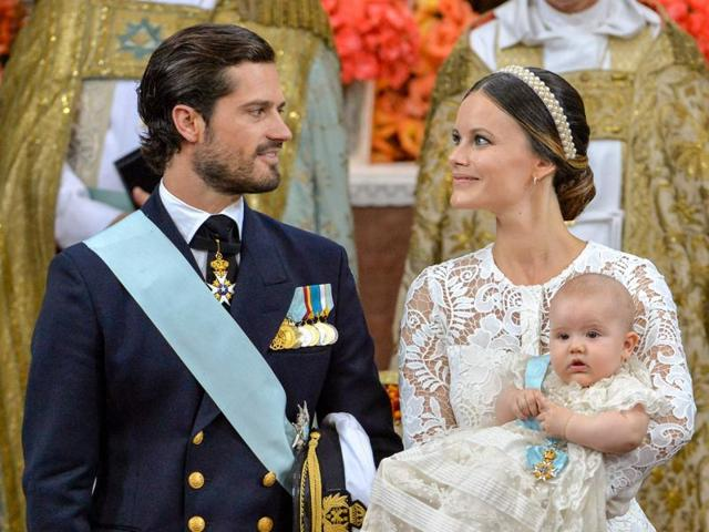 Prince Carl Philip and Princess Sofia with Prince Alexander pictured at Palace Chapel in Drottningholm Palace in Stockholm during the christening of the five month-old Prince on Friday.