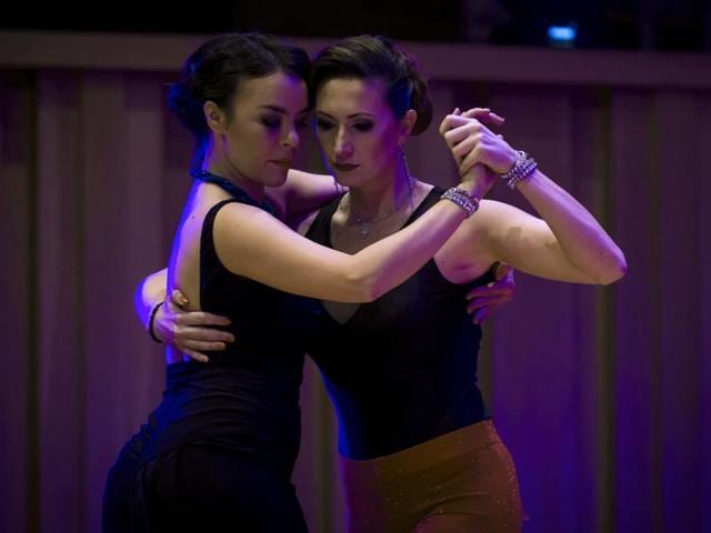 Argentina's tango dancers Liliana Chenlo (R) and Yuko Artak perform during the Tango salon competition of the 18th Tango Dance World Championship in Buenos Aires on August 23, 2016. This year, for the first time, a women couple competes including queer tango in a dance associated with male chauvinism.