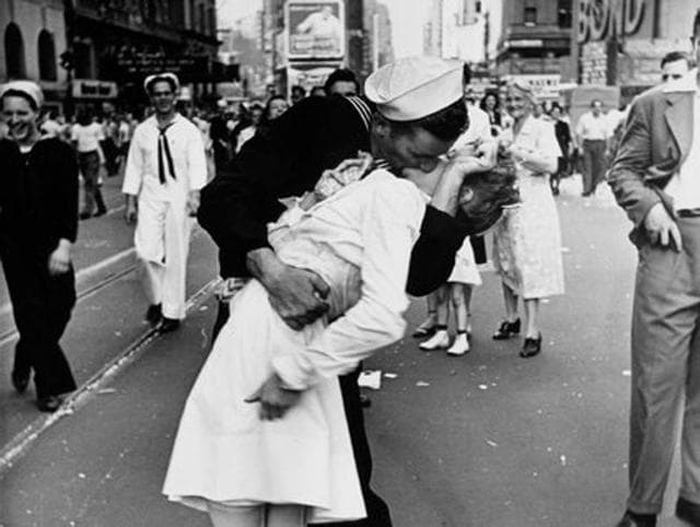 People visit the exhibition of German-American 'Life' magazine photographer Alfred Eisenstaedt at Moscow's Jewish Museum and Tolerance Center in April 2015. On display is the famous photograph taken by Eisenstaedt of a sailor kissing a nurse in New York's Times Square on V-J Day on August 14, 1945.