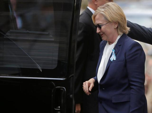 US Democratic presidential candidate Hillary Clinton leaves the ceremony, marking the 15th anniversary of the September 11 attacks in New York.