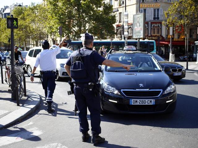 Police officers divert traffic away from the Gare de Lyon railway station in Paris, France, during a bomb scare.