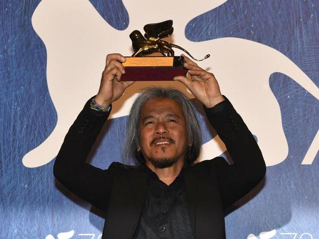 Filipino filmmaker Lav Diaz holds the Golden Lion award for his movie  Ang Babaeng Humayo  (The Woman Who Left) at the awards ceremony of the 73rd Venice International Film Festival, in Venice, Italy, Saturday,